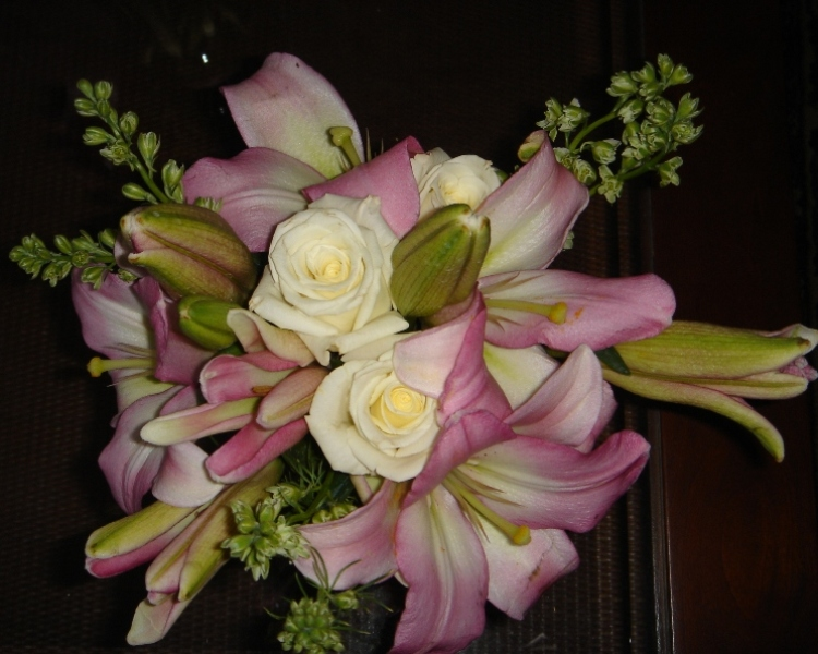 A close-up of some lilies and roses in a vase I got last year for my birthday